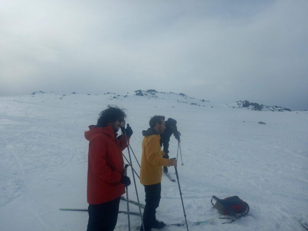 Luke and Hugh stand on skis